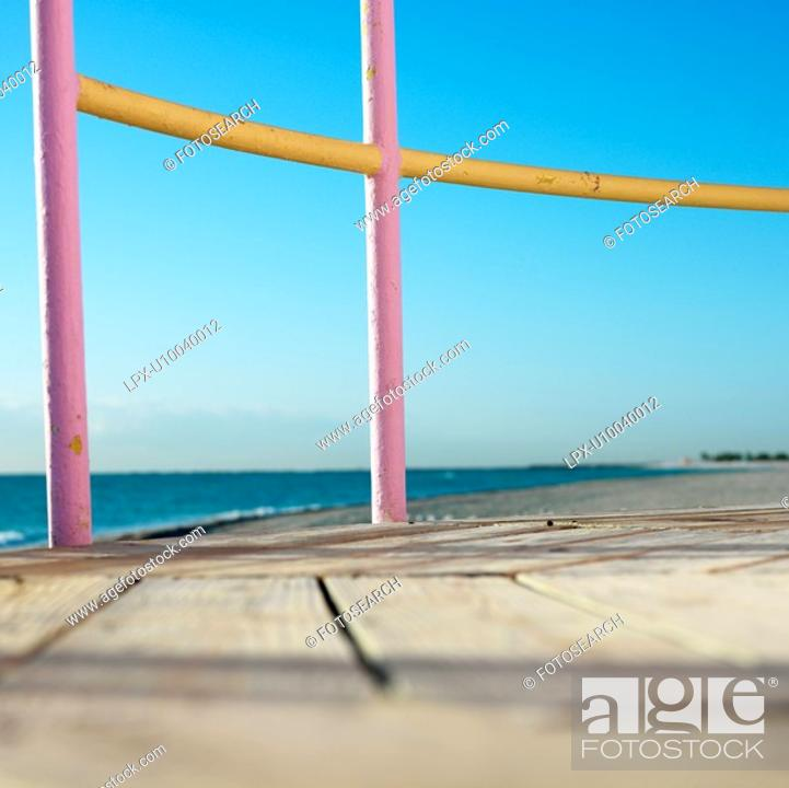 Stock Photo: Pink and yellow painted railings of lifeguard tower on beach in Miami, Florida, USA.