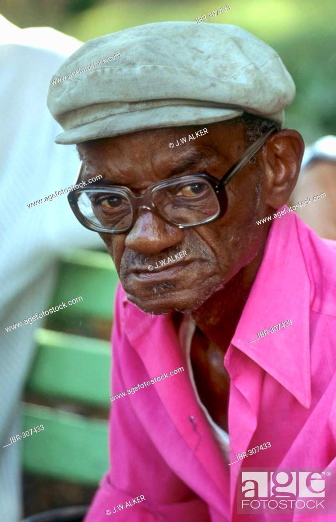 b33faeaa7 Old dark-skinned man with glasses, Havanna Cuba, Stock Photo ...