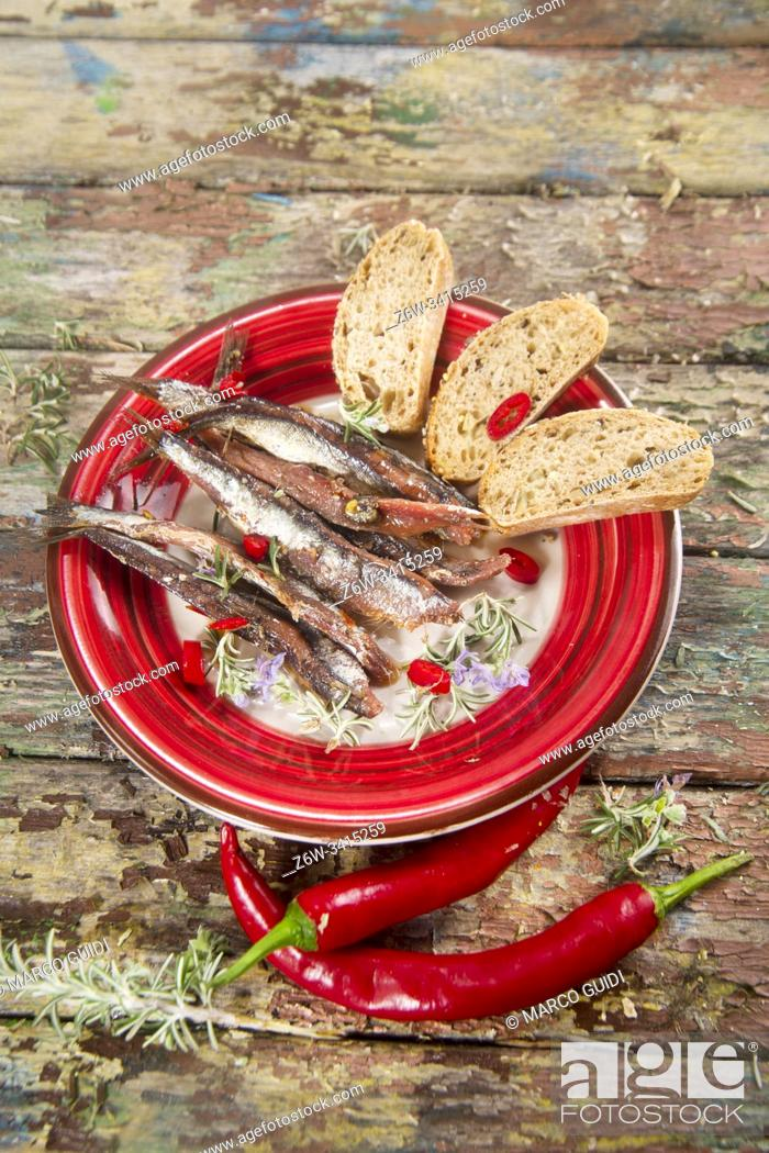 Stock Photo: Presentation of a dish based on spicy chili anchovies.