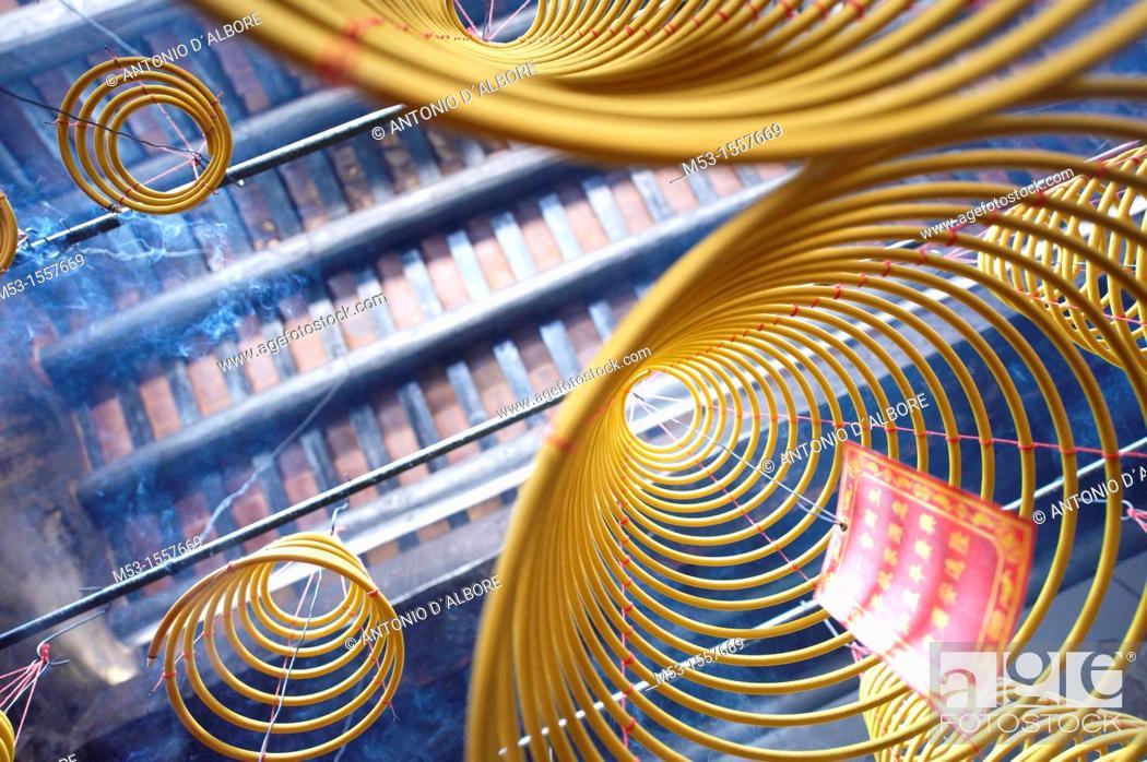 Stock Photo: Burning spiral joss incense at Tin Hau Temple  Taipa Village  Macau  China.