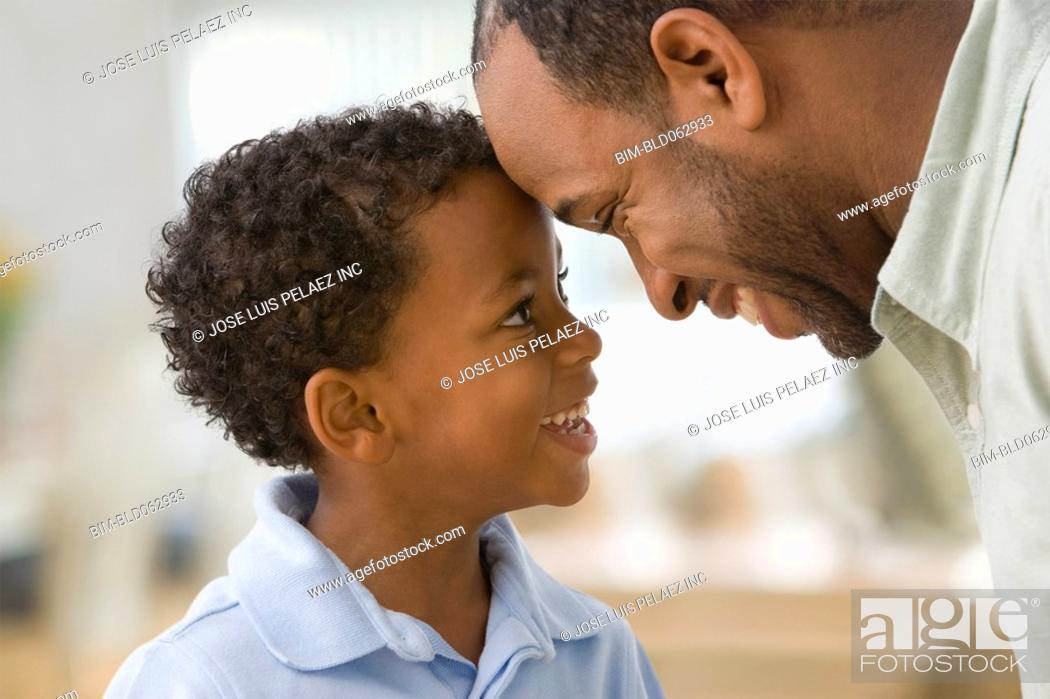 Stock Photo: African father and son face to face.