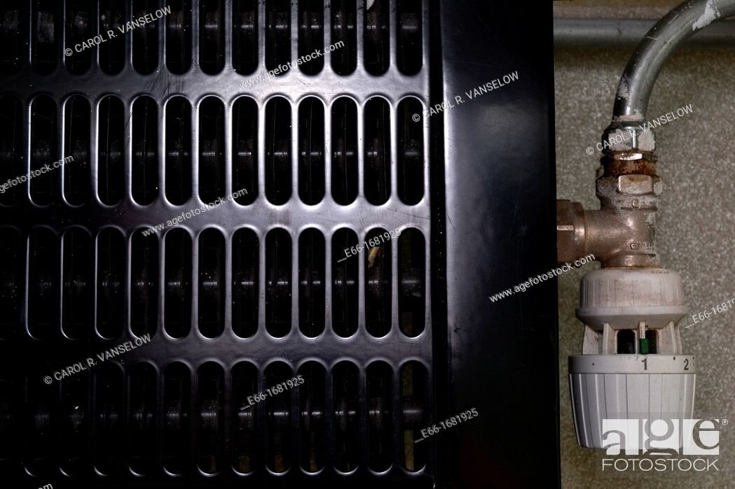 Stock Photo: Radiator with gas turned down to very low setting - saving energy.