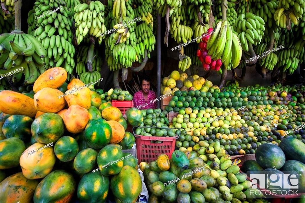 Stock Photo: Sri Lanka, Asia, Kandy City, Fruits Shop, fruit, female vendor, stand, woman, bananas, melons, exotic, tropical, shopp.