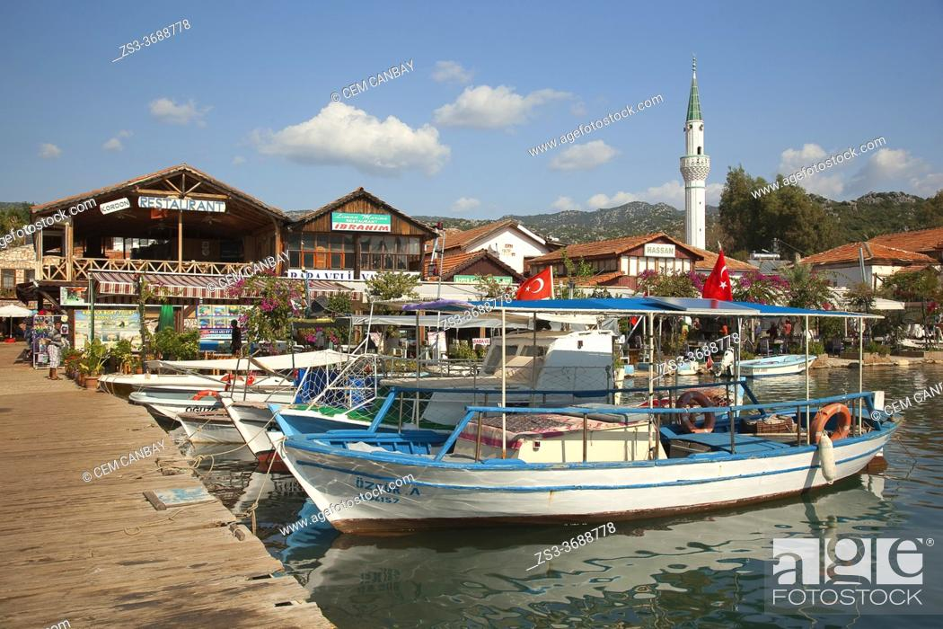 Stock Photo: View to the fishing boats at the harbor of Ucagiz-Üçağız with the traditional houses at the background, Demre, Antalya Province, Mediterranean Coast.