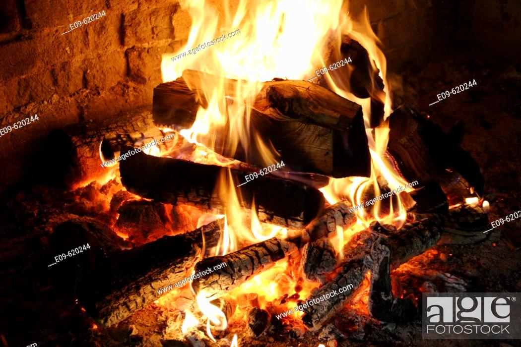 Stock Photo: fire in stone or brick fireplace, glowing coals, plentiful yellow and white flames.
