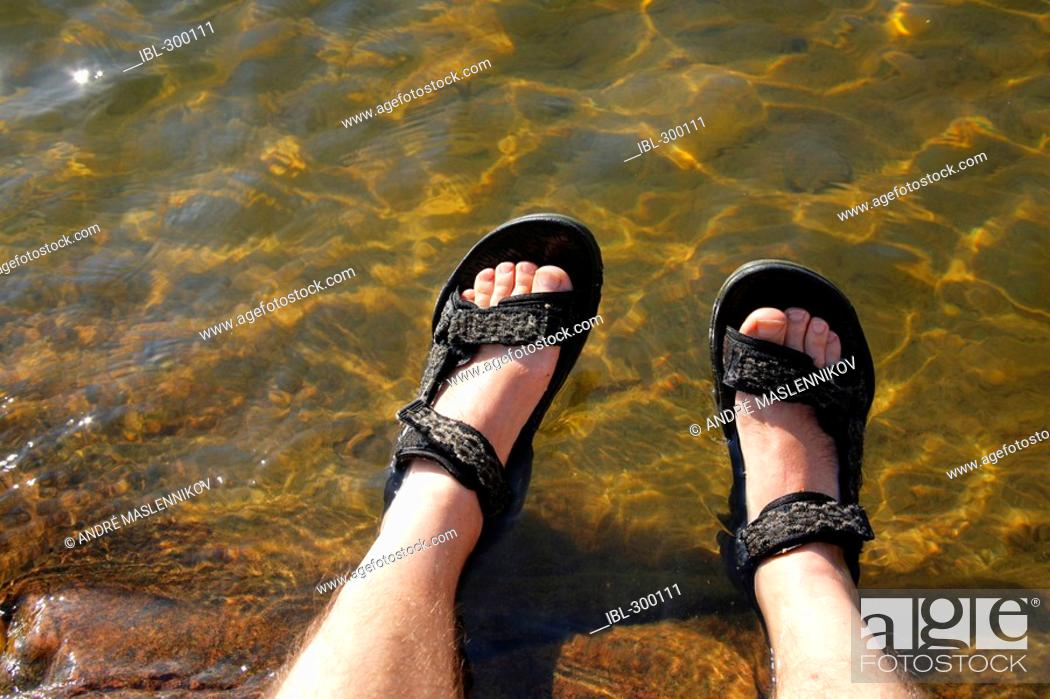 Stock Photo: Feet in water.