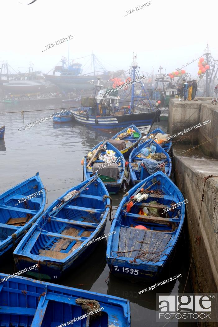 Stock Photo: Essaouira fishing harbour in the morning with fog, Morocco, Africa.