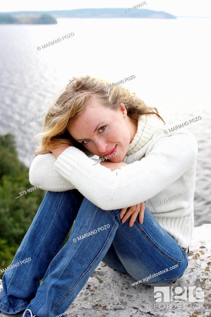 Stock Photo: 30 years old woman in a relaxed position in Maladieski Kurdan Natural Park in Toglyatty, Samara Region, Russian Federation, Russia.