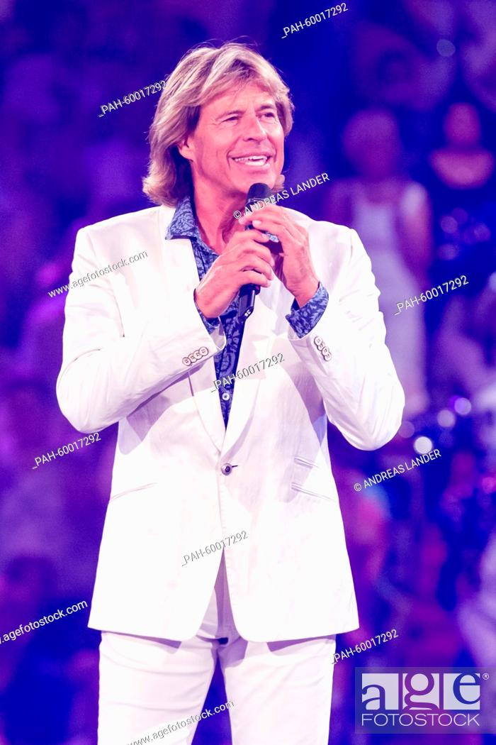 Stock Photo: Singer Hansi Hinterseer performs on stage at the TV live show 'Die Besten im Sommer' (lit. The best in summer) at the Erdgasarena in Riesa, Germany.