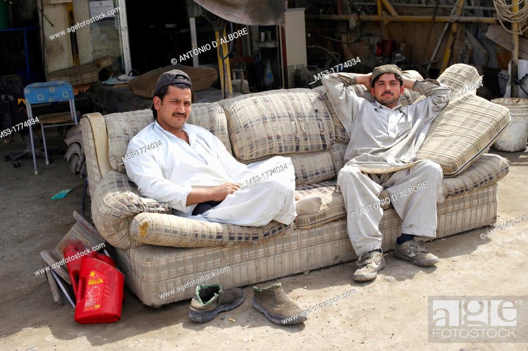 Stock Photo: two pakistani man waiting for customer in a mechanical repairs workshop  old ras al-khaimah  ras al-khaimah  united arab emirates  middle east.