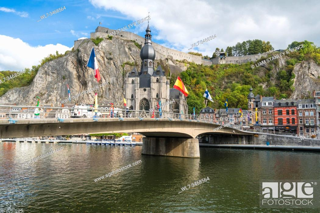 Stock Photo: Charles de Gaulle bridge crossing the river Meuse in the picturesque town of Dinant with it's Collegiate Church on the river bank and Citadel perched high on.