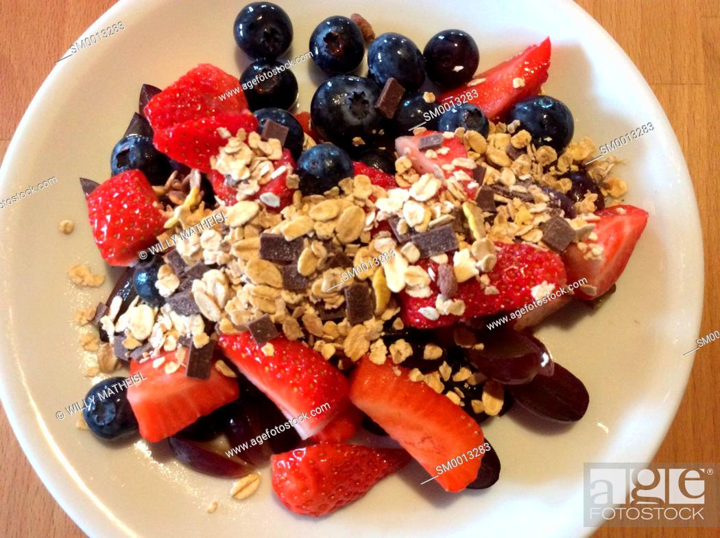 Stock Photo: blueberries, strawberries and cereals in white bowl.