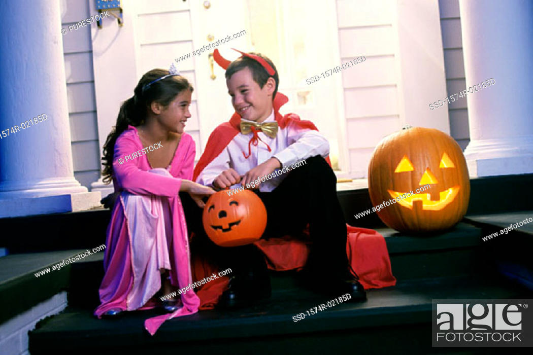 Stock Photo: Boy and a girl dressed in Halloween costumes.
