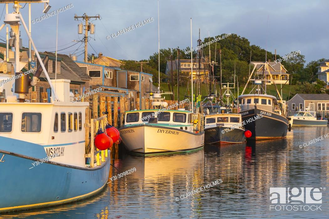 Stock Photo: Commercial fishing boats docked in Menemsha Basin, in the fishing village of Menemsha in Chilmark, Massachusetts on Martha's Vineyard.