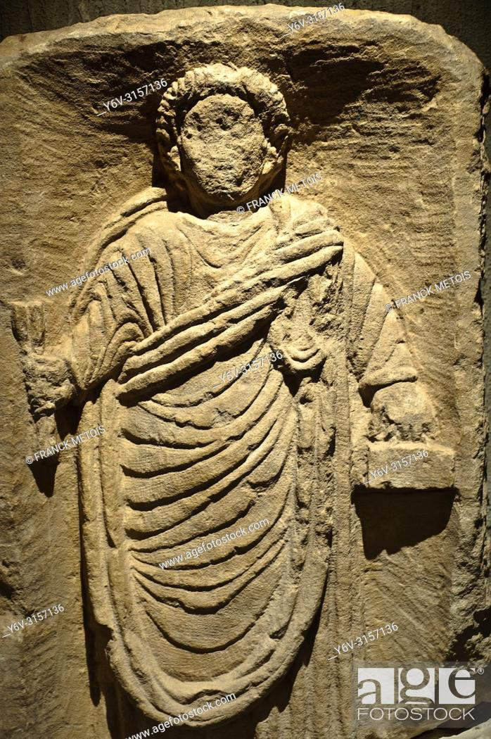 Stock Photo: Funerary stele representing a scribe ( I° or II° century AD). At Musée Sainte-Croix ( Poitiers, France).