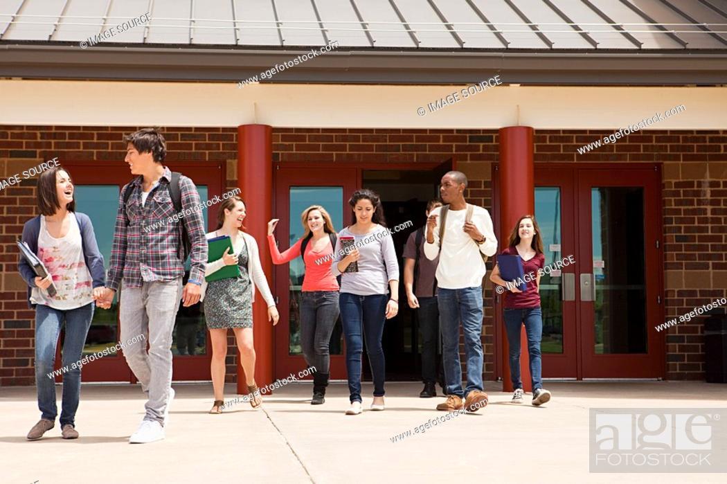 Stock Photo: High school students leaving school building.