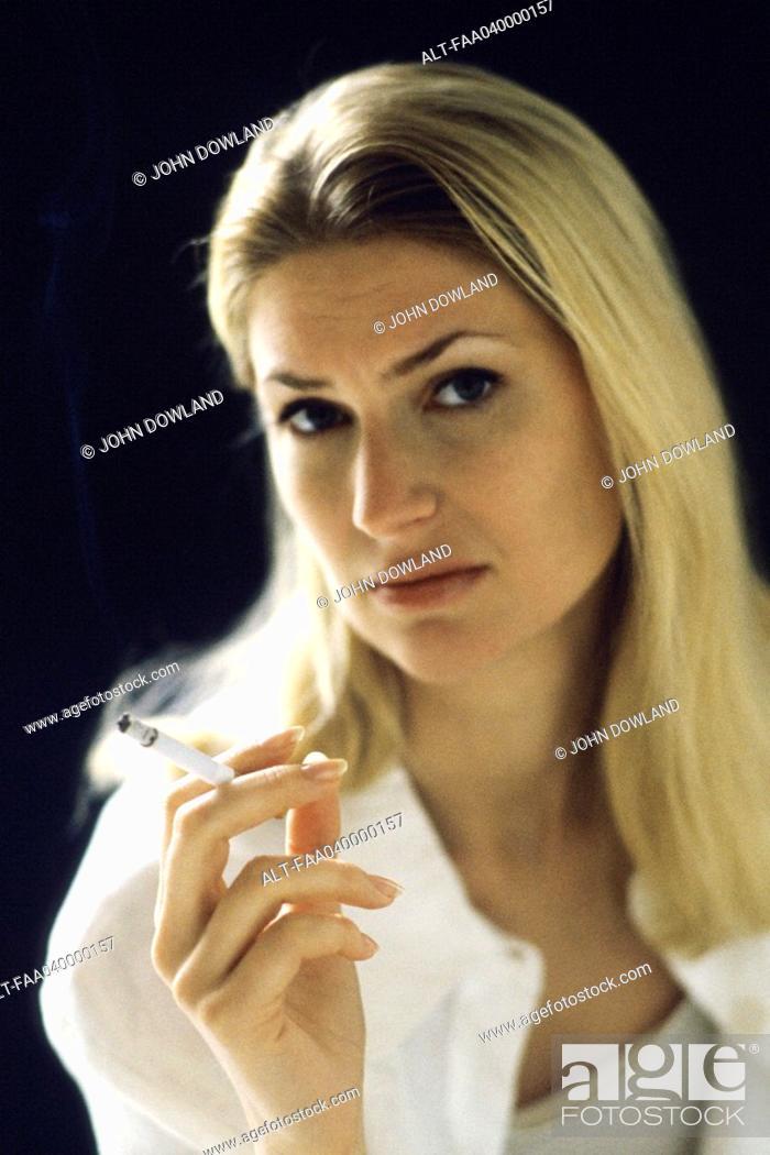 Stock Photo: Woman holding cigarette, portrait.