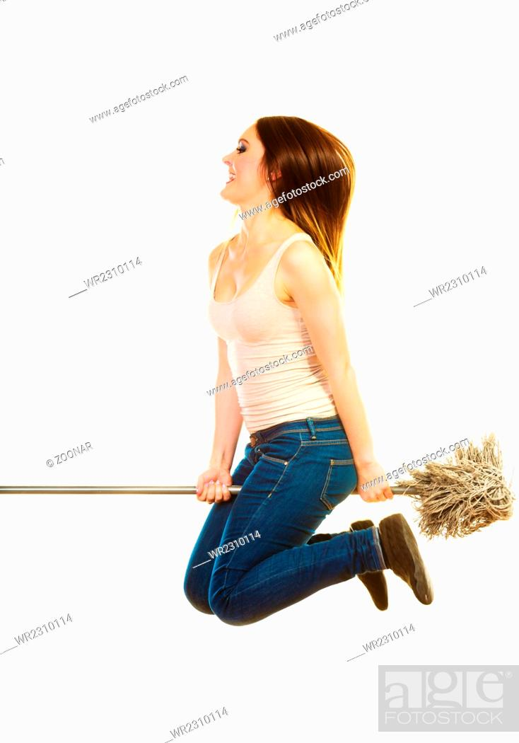 Funny cleaning woman with mop flying, Stock Photo, Picture