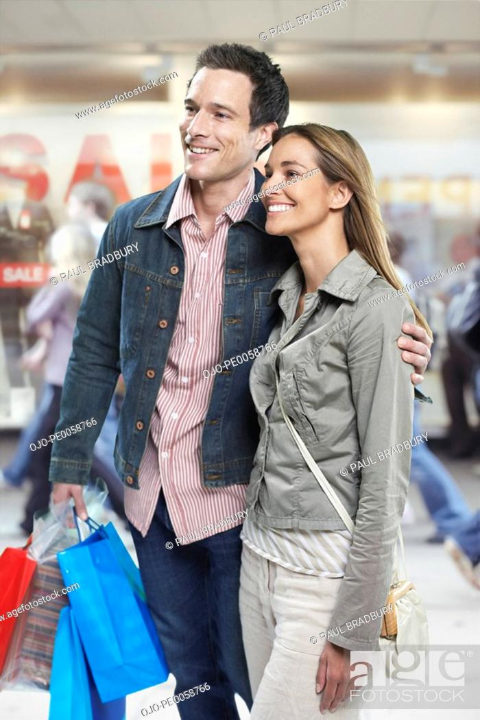Stock Photo: Couple shopping in mall.