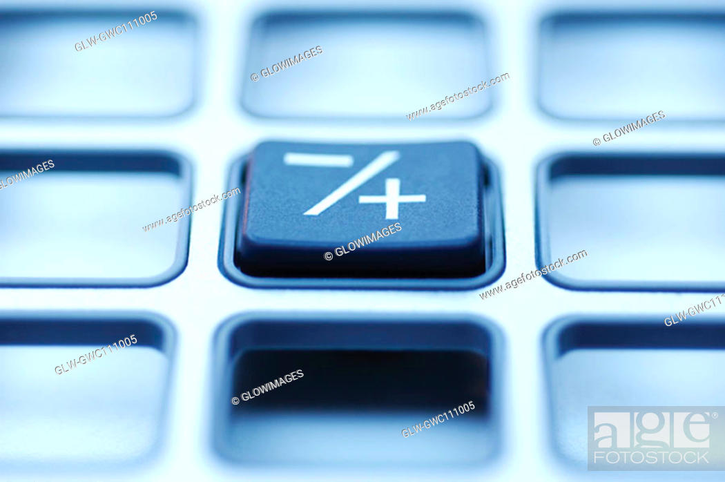 Stock Photo: Close-up of a button on a calculator.