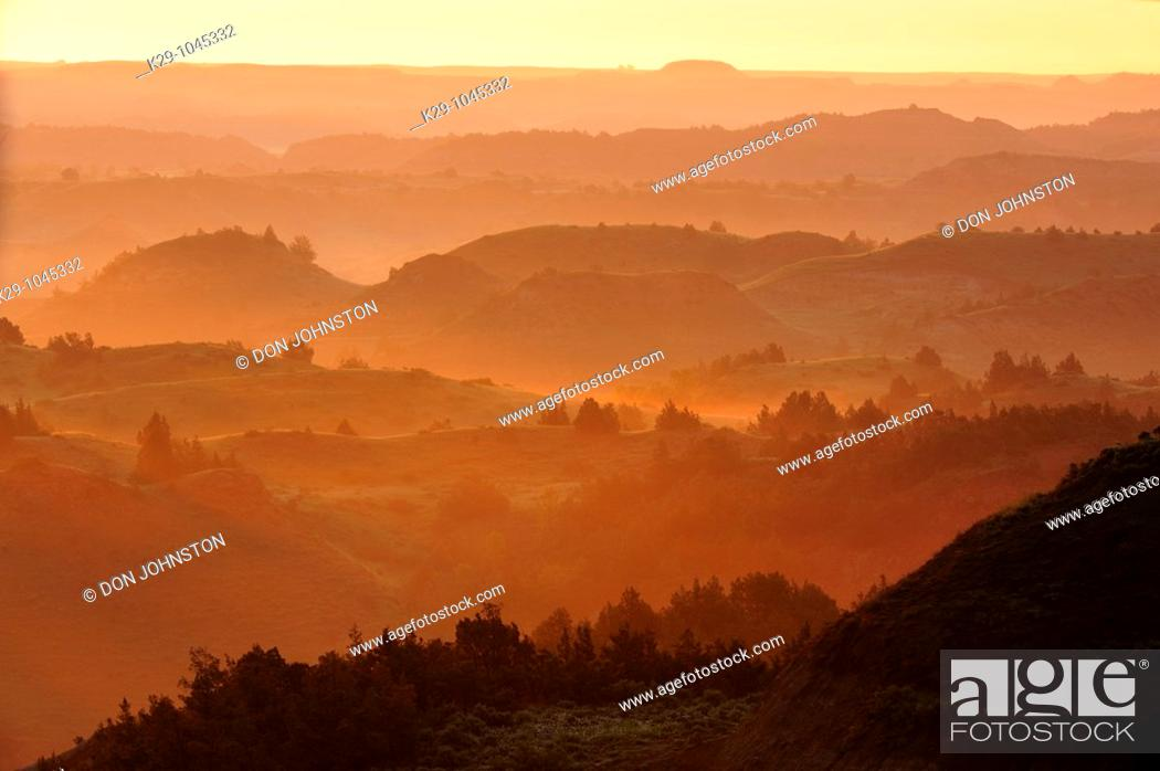 Stock Photo: Sunrise and light fog from the Badlands Overlook.
