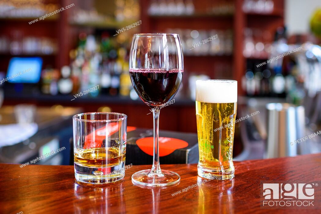 Stock Photo: Oudenbosch - Nederland - Bar with a glass of beer wine and whiskey.
