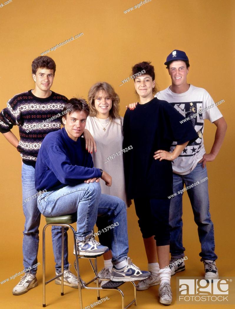 Stock Photo: Studio portrait of a group of five happy teenagers in casual clothes.