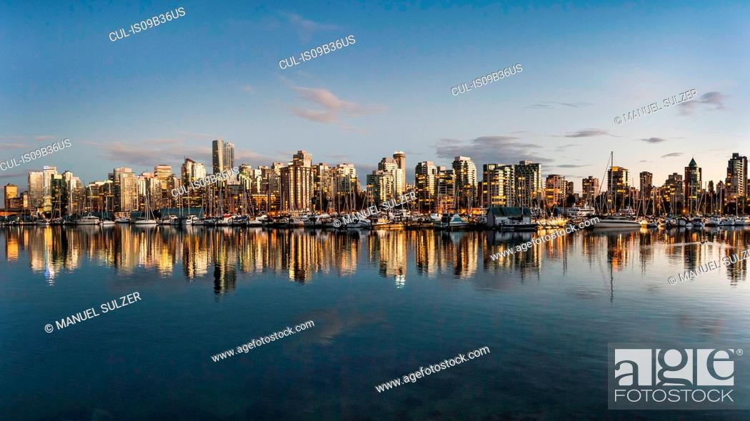 Stock Photo: View of harbour and city skyline at dusk, Vancouver, Canada.