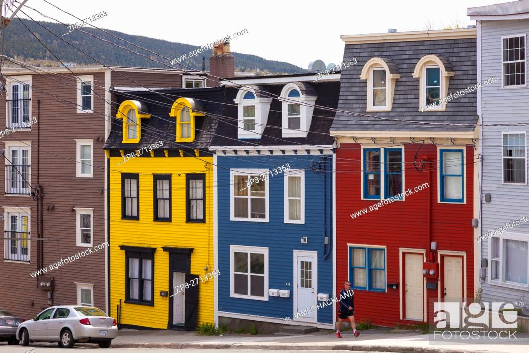 Jelly Bean Row >> A Person Passing By Colourful Row Houses Jellybean Row In Downtown