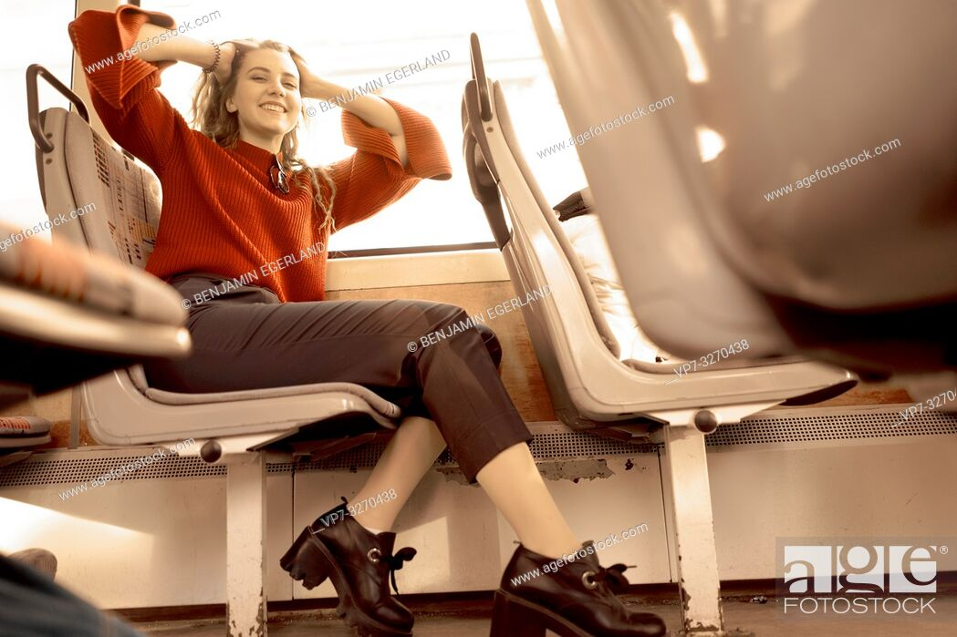 Stock Photo: young happy woman sitting in public transport, in city Cottbus, Brandenburg, Germany.