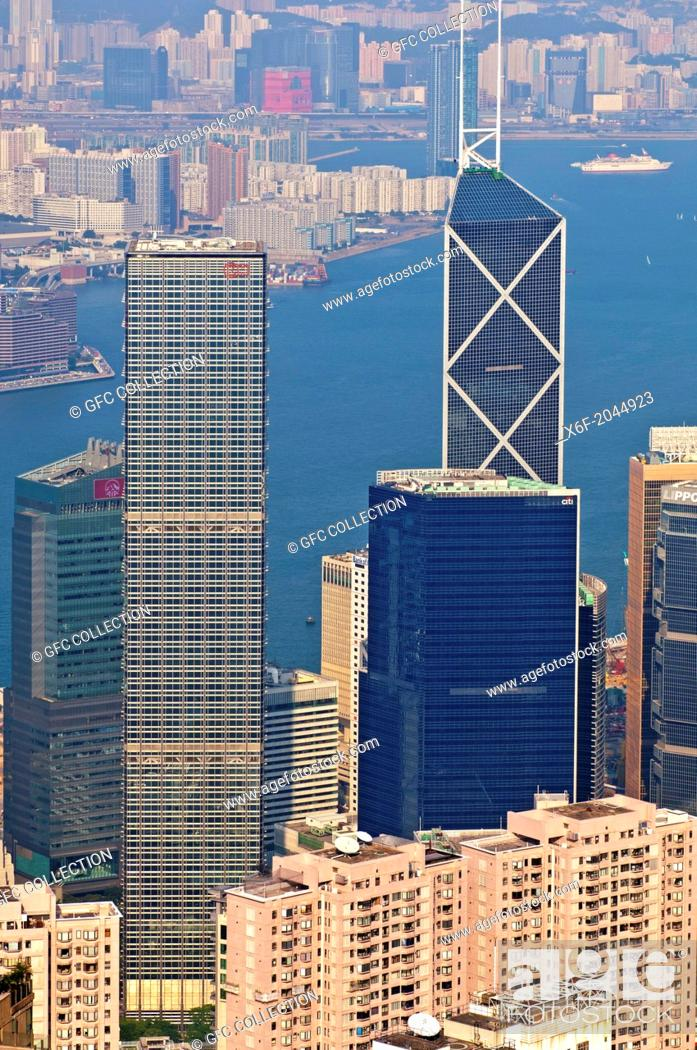 Stock Photo: High-rising business buildings and the Bank of China Tower in the Central District against the Victoria Harbour, Hong Kong.
