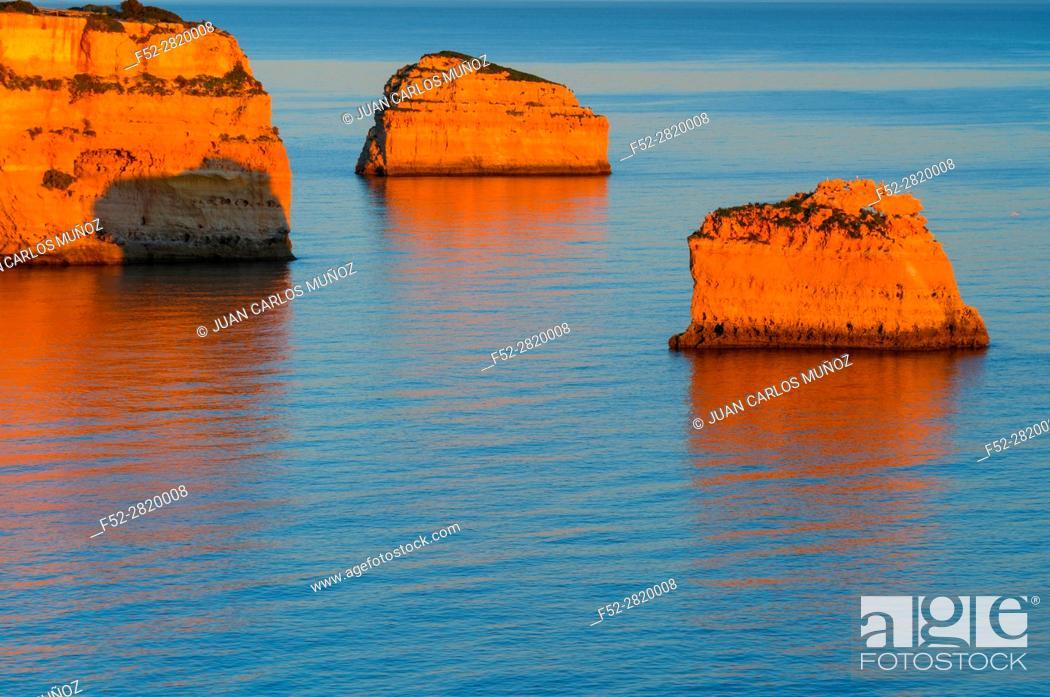 Stock Photo: Cliffs along Praia da Marinha at Atlantic Ocean at sunset, Algarve, Portugal.