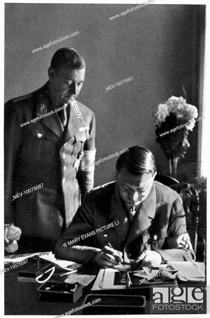 Stock Photo: ADOLF HITLER Working at his desk in the Braune Haus, Munich, circa 1933.
