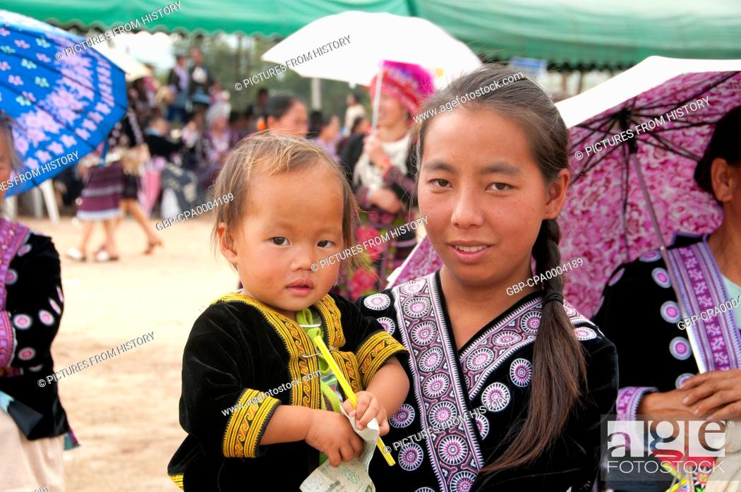 Thailand: Mother and child, Hmong New Year celebrations, Chiang Mai