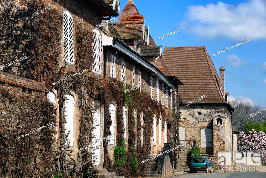 Stock Photo: Montaiguët-en-Forez, architecture along main street - Rue Pierre de la Fin, Allier department, Auvergne-Rhône-Alpes region, central France, Europe.