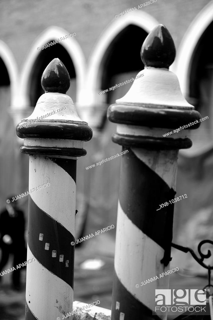 Stock Photo: Typical mooring boats poles of red and white next to the Rialto Market in Venice.