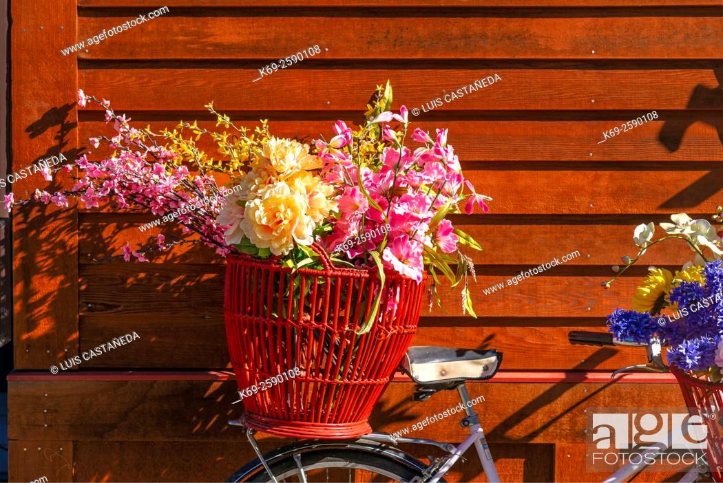 Stock Photo: Still Life. Bicycle with Flowers against a red wood wall.