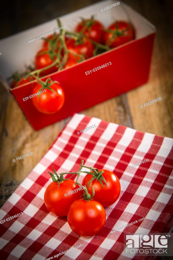 Stock Photo: Fresh cherry tomatoes on travel and wooden background, France.