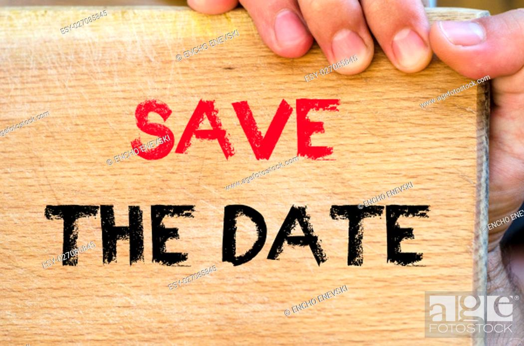 Stock Photo: Human hand over wooden background and save the date text concept.
