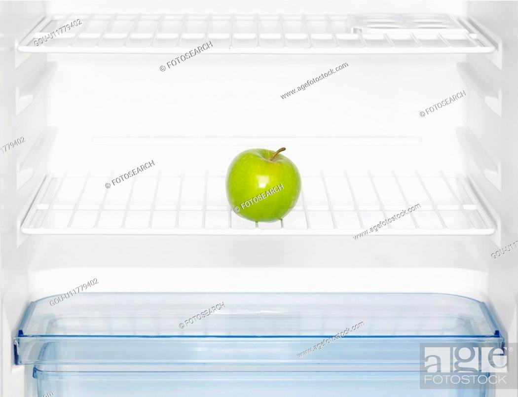 Stock Photo: Green apple in fridge (close-up).