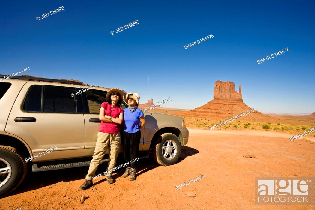 Stock Photo: Asian mother and daughter in desert.