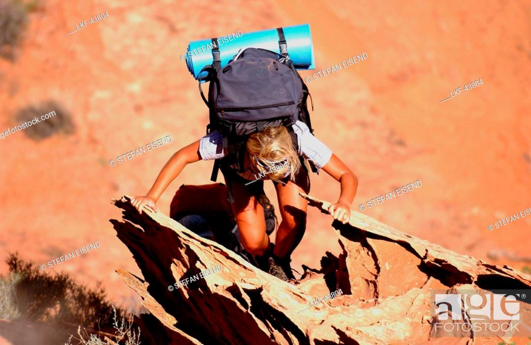 Stock Photo: A woman hiking at Lake Powell, Arizona, Utah, USA, MR.