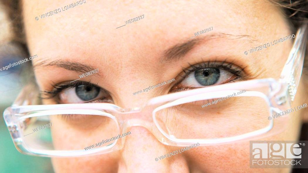 Stock Photo: Young woman wearing glasses, close-up.