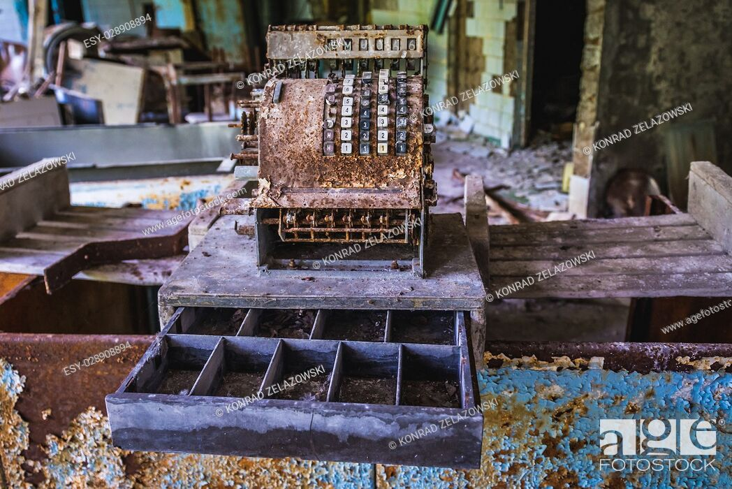 Stock Photo: Old rusty cash register in High school No 2 in Pripyat ghost city of Chernobyl Nuclear Power Plant Zone of Alienation in Ukraine.