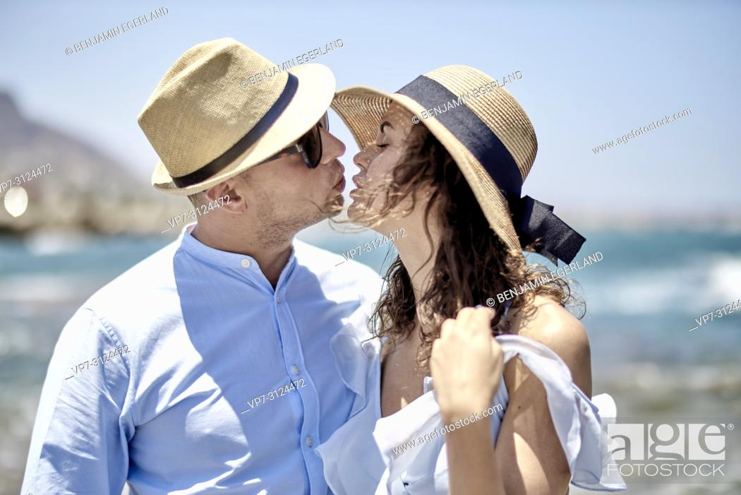 Stock Photo: couple at beach, lovers, dating, in Hersonisssos, Crete, Greece.