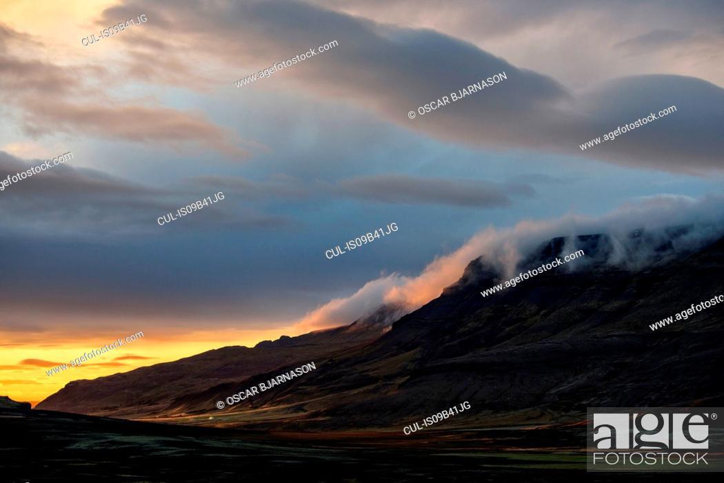 Stock Photo: Sunset behind mountain range, Mosfellsheidi, Iceland.