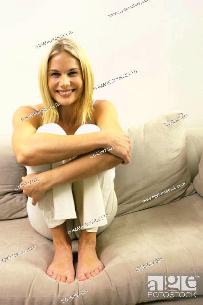 Stock Photo: Girl sitting on sofa.