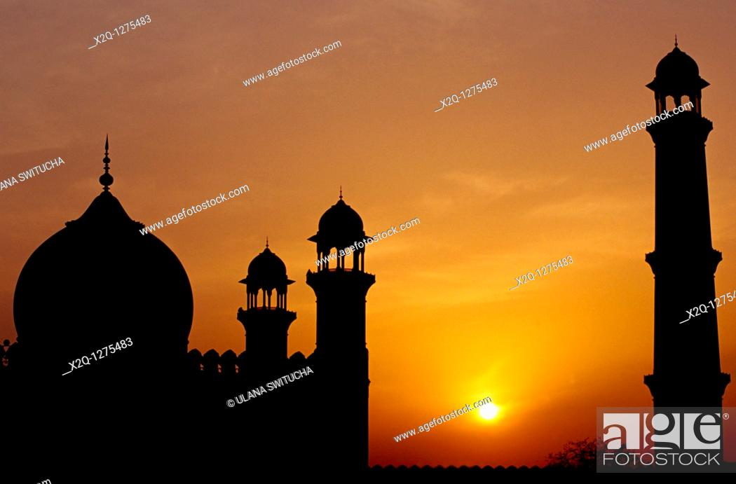 Stock Photo: At sunset, a silhouette of the Badshahi Mosque in Lahore Pakistan.