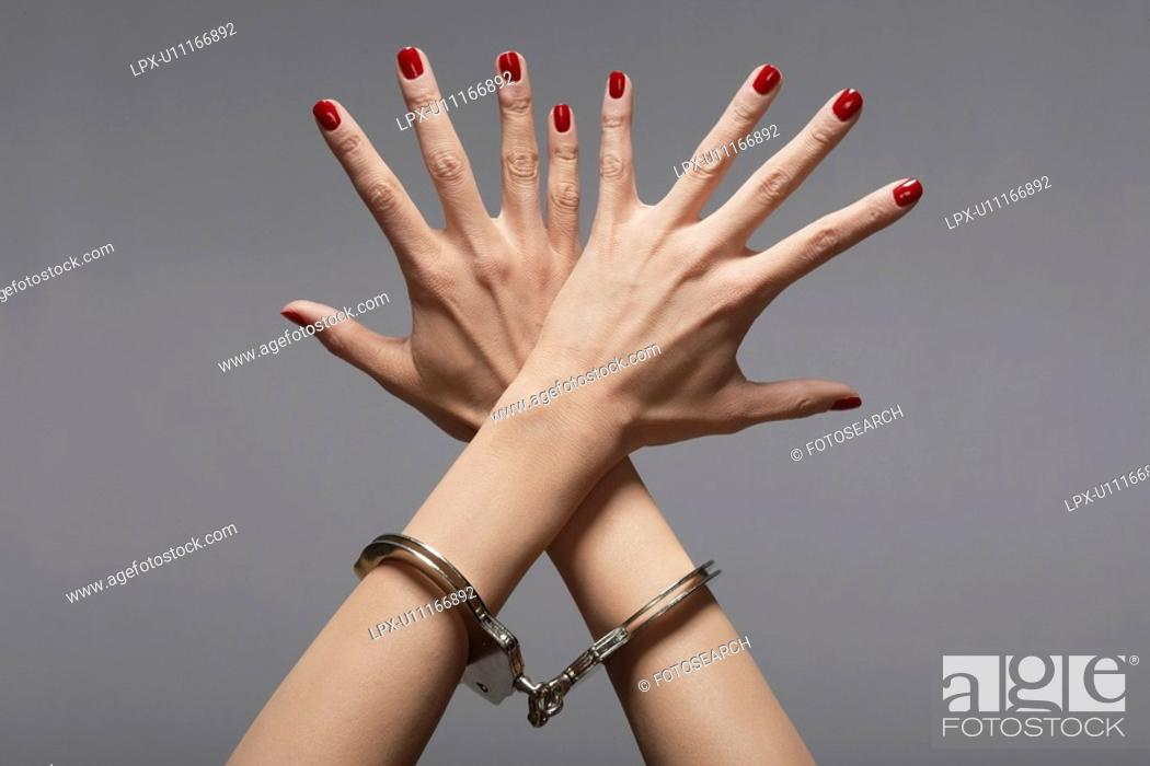 Stock Photo: Woman's hands in handcuffs close-up.