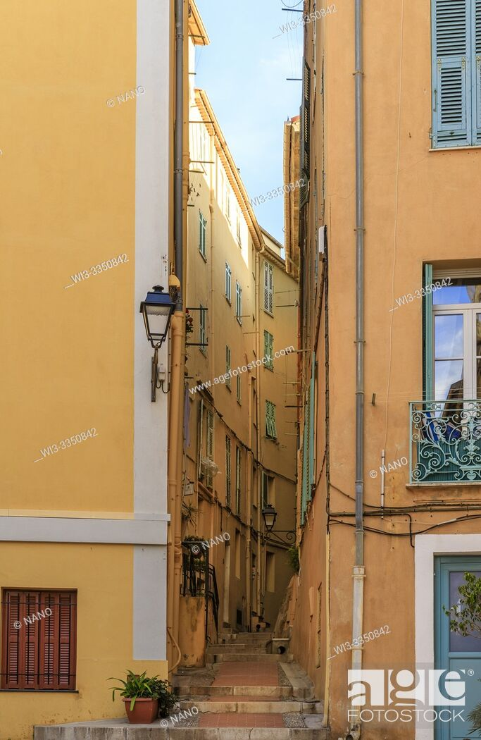 Stock Photo: France, Alpes Maritimes, Menton, narrow street in the old town.